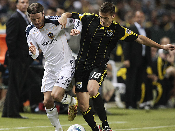 Robbie Rogers (right) came to prominence in Major League Soccer playing for the Columbus Crew from 2007 through 2011. (Bret Hartman/AP file photo)