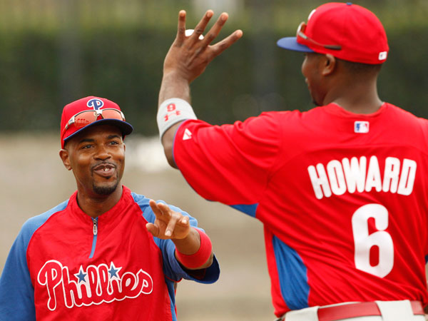 Jimmy Rollins laughs with teammate Ryan Howard after spring training infield drills in Clearwater, FL on Friday, February 15, 2013. (Yong Kim/Staff Photographer)
