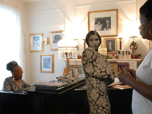 Blanche Burton-Lyles, founder of the Marian Anderson Historical Society, plays piano at the Marian Anderson Residence and Museum as Cheryl Gay listens.