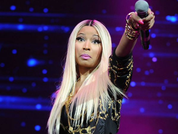 FILE - This Nov. 2, 2013 file photo shows hip-hop artist Nicki Minaj at the Power 105.1´s Powerhouse Concert at the Barclays Center in New York. Minaj is being criticized after using a photo of Malcolm X with a gun in his hands, juxtaposed with a racial slur, for her new single. Minaj posted the photo Wednesday, Feb. 12, 2014, on her website and Instagram page. (Photo by Brad Barket/Invision/AP, File)