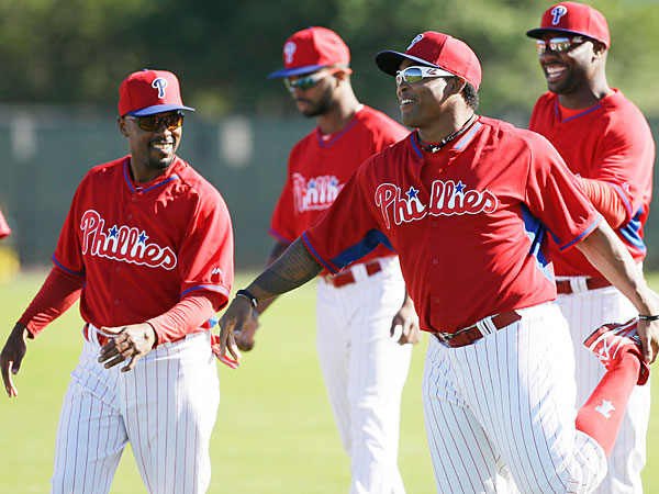 Phillies outfielder Marlon Byrd stretches with teammates during spring training baseball practice. (Charlie Neibergall/AP)