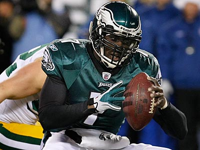 Michael Vick´s tendency to extend plays by holding on to the ball often got him in trouble. (Ron Cortes/Staff file photo)