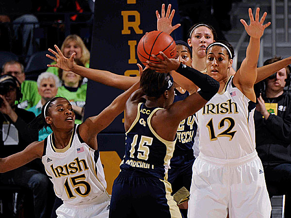 Georgia Tech guard Tyaunna Marshall tries to pass around Notre Dame guard Lindsay Allen and Taya Reimer. (Joe Raymond/AP)