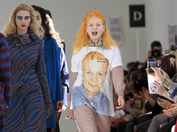 Designer Vivienne Westwood, centre right, takes the applause following her show, during London Fashion Week, at the Saatchi Gallery in west London, Sunday, Feb. 17, 2013. (Photo by Joel Ryan/Invision/AP)