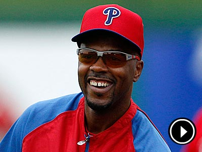 Phillies&acute; shortstop Jimmy Rollins smiles while catching the baseball<br />during spring training in Clearwater, FL on Friday, February 15, 2013.<br /> ( Yong Kim / Staff Photographer )