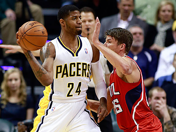 Pacers forward Paul George passes the basketball as Hawks guard Kyle Korver defends. (R Brent Smith/AP)