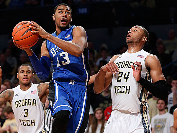 Duke guard Matt Jones drives past Georgia Tech forward Kammeon Holsey. (John Bazemore/AP)