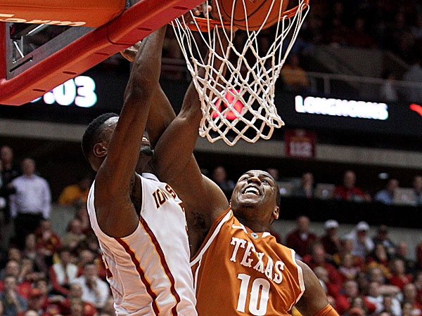 Iowa State forward Melvin Ejim tries to dunk as Texas forward Jonathan Holmes defends. (Justin Hayworth/AP)