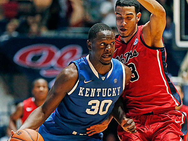 Kentucky forward Julius Randle dribbles up court against Mississippi forward Anthony Perez. (Rogelio V. Solis/AP)