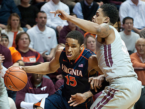 Virginia´s Malcolm Brogdon drives on Virginia Tech´s Jarell Eddie. (Don Petersen/AP)