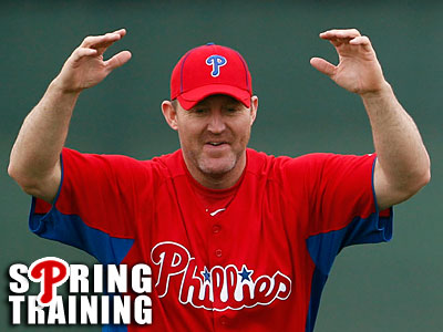 Jim Thome stretches his arms during a spring training workout in Clearwater, Fla. (Yong Kim/Staff Photographer)