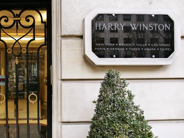 FILE - This is a  Friday Dec. 5, 2008 file photo of f the entrance of the Harry Winston jewelry store near the Champs-Elysees in Paris. While Christmas shoppers strolled outside the posh Harry Winston jewelry shop near Paris´ famed Champs-Elysees Avenue in 2008, armed thieves  some dressed as women and wearing wigs  entered the store and made away with gems and bejeweled watches worth up to $85 million, according to French police. (AP Photo/Francois Mori, File)