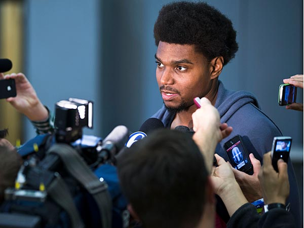 Philadelphia 76ers center Andrew Bynum speaks to reporters at the team´s NBA basketball training facility Wednesday, Oct. 24, 2012, in Philadelphia. Bynum remains sidelined with right knee pain and is a long shot to play in the Oct. 31 opener. (AP Photo/Matt Rourke)