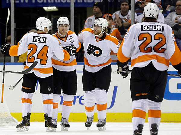The Flyers´ Claude Giroux celebrates his goal with teammates Matt Read, Jakub Voracek and Luke Schenn during the second period. (Seth Wenig/AP)