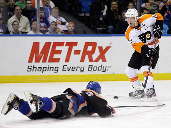 The Islanders players are famous for yelping and falling to the ice if you just yell at them. (AP Photo/Seth Wenig)