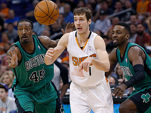 The Suns´ Goran Dragic slips through the defense of the Celtics´ Gerald Wallace and Jeff Green. (Ross D. Franklin/AP)