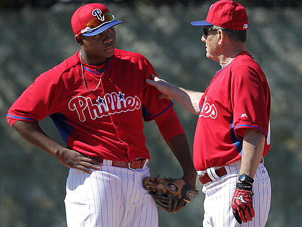 Phillies coach Larry Bowa, right, talks with Maikel Franco. (David Maialetti/Staff Photographer)