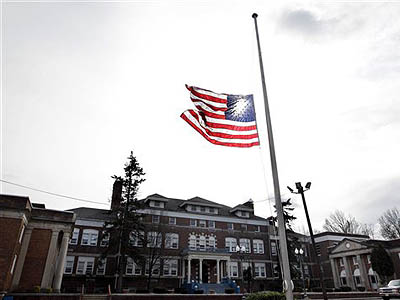 An American flag flies at half-staff in front of The Whitney E. Houston Academy of Creative and Performing Arts in East Orange, N.J., Sunday, Feb. 12, 2012. As a young girl, Houston attended what was known then as the Franklin School. Houston, who ruled as pop music´s queen until her majestic voice and regal image were ravaged by drug use, erratic behavior and a tumultuous marriage to singer Bobby Brown, died Saturday. She was 48. (AP Photo / Mel Evans)