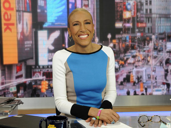 "This Jan. 24, 2013 photo released by ABC shows Robin Roberts on ""Good Morning America,"" in New York. Roberts will be back on the job at the ""Good Morning America"" anchor desk on Feb. 20. Her return will be five months to the day since her bone marrow transplant to treat a rare blood disorder. (AP Photo/ABC, Ida Mae Astute)"