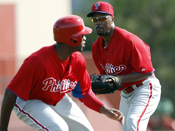 Jimmy Rollins chases down Domonic Brown during Phillies Spring Training on Tuesday, February 19, 2013. (Yong Kim/Staff Photographer)