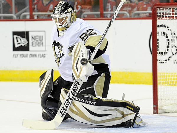 Pittsburgh Penguins goalie Tomas Vokoun (92), of the Czech Republic, eyes the puck against the Washington Capitals during the first period of an NHL hockey game, Sunday, Feb. 3, 2013, in Washington. (AP Photo/Nick Wass)