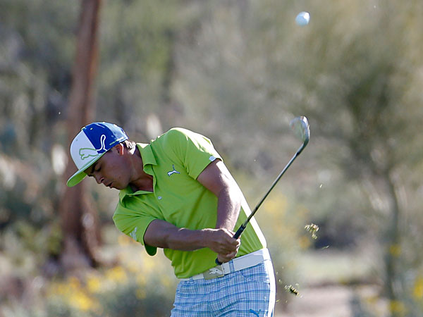 Rickie Fowler hits from the fairway on the second hole in his match against Jimmy Walker during the second round of the Match Play Championship golf tournament on Thursday, Feb. 20, 2014, in Marana, Ariz. (Matt York/AP)