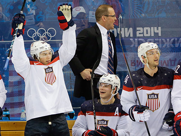 Team USA player reacts from the bench after a goal by forward Phil Kessel during the third period of men´s quarterfinal hockey game against the Czech Republic in Shayba Arena at the 2014 Winter Olympics, Wednesday, Feb. 19, 2014, in Sochi, Russia. (David J. Phillip/AP)