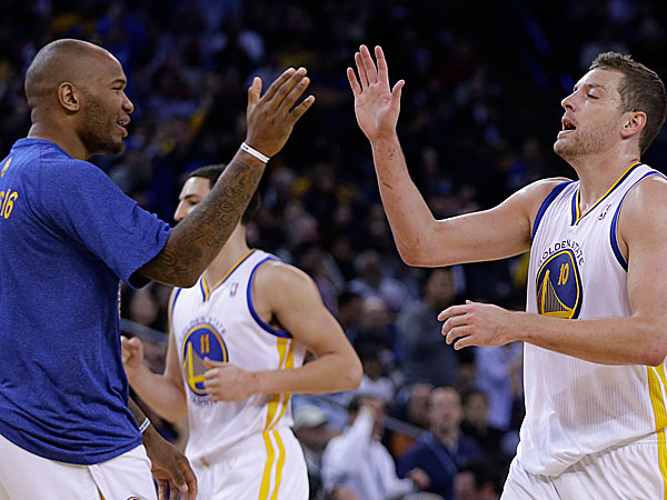 The Warriors´ David Lee, right, is congratulated by Marreese Speights (5) during a timeout in the second half of an NBA basketball game against the Houston Rockets Thursday, Feb. 20, 2014, in Oakland, Calif. (Ben Margot/AP)