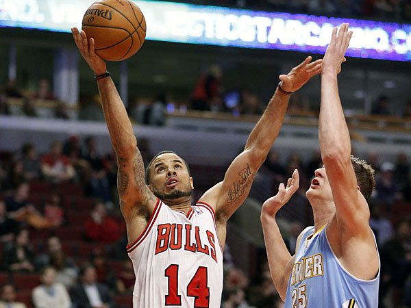 Bulls guard D.J. Augustin (14) shoots past Denver Nuggets center Timofey Mozgov, right, during the second half of an NBA basketball game Friday, Feb. 21, 2014, in Chicago. The Bulls won 117-89. (Charles Rex Arbogast/AP)