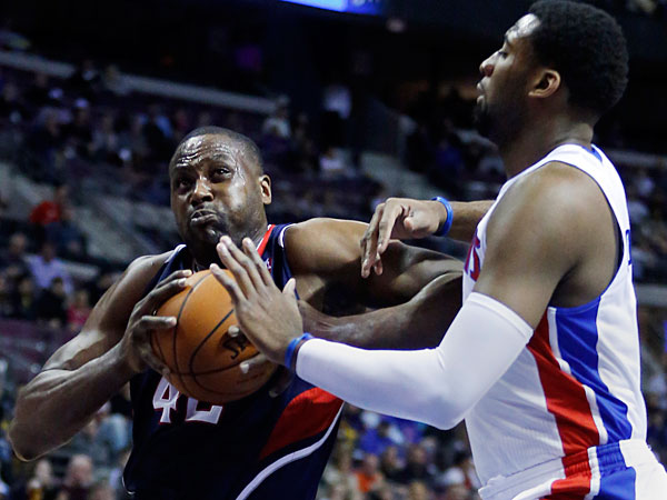 Hawks forward Elton Brand (42) drives to the basket against Detroit Pistons center Andre Drummond, right, during the first half of an NBA basketball game Friday, Feb. 21, 2014, in Auburn Hills, Mich. (Duane Burleson/AP)