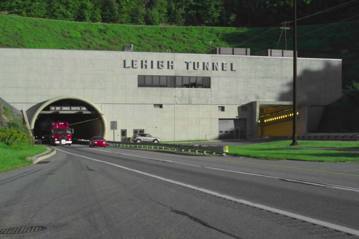 A section of electrical conduit fell from the roof of a Pennsylvania Turnpike tunnel, crashed through a windshield of a truck and struck the driver in the head, killing him, police said.