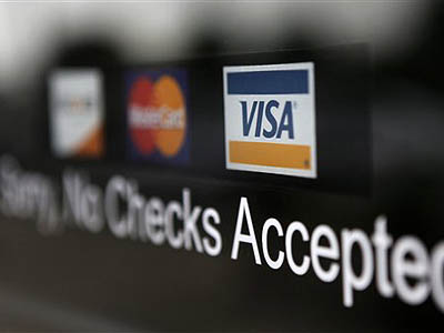 New credit card regulations that began Monday will prevent banks from using unfair practices that dig borrowers deeper into debt. (AP Photo/Paul Sancya, file)