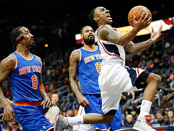 Hawks point guard Jeff Teague drives past Knicks shooting guard J.R. Smith and center Tyson Chandler. (John Bazemore/AP)