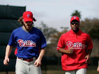 Jimmy Rollins and Jayson Werth run through drills during Phillies spring training in Clearwater, Fla. (David Swanson / Staff Photographer)