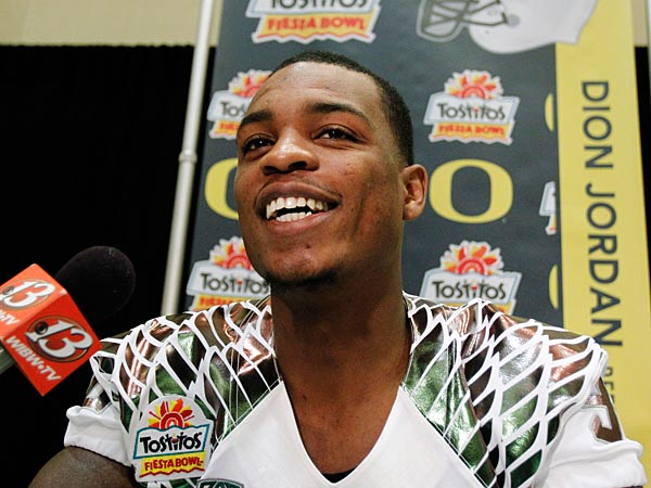 Oregon defensive end Dion Jordan answers a reporter´s question during media day for the Fiesta Bowl NCAA college football game, Monday, Dec. 31, 2012, in Scottsdale, Ariz. Oregon is scheduled to play Kansas State on Jan. 3, 2013, in Glendale. (AP Photo/Paul Connors)