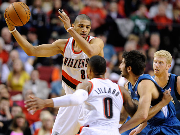 The Timberwolves´ Ricky Rubio (9) defends as Portland Trail Blazers´ Nicolas Batum (88) looks to pass during the first half of an NBA basketball game in Portland, Ore., Sunday Feb. 23, 2014. (Greg Wahl-Stephens/AP)