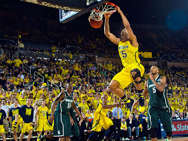 Michigan forward Jon Horford (15) slams a dunk in the second half of an NCAA college basketball game against Michigan State at Crisler Center in Ann Arbor, Mich., Sunday, Feb. 23, 2014. Michigan won 79-70. (Tony Ding/AP)