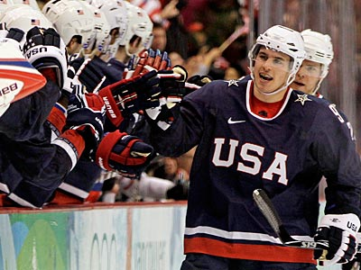 Zach Parise is congratulated after scoring a goal in Team USA´s quarterfinal game against Switzerland. (AP Photo/Julie Jacobson)