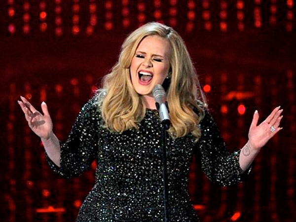 Singer Adele performs during the Oscars at the Dolby Theatre on Sunday Feb. 24, 2013, in Los Angeles.  (Photo by Chris Pizzello/Invision/AP)<br />