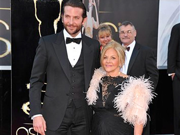 "It was a winning moment for Philly when Bradley Cooper and his date, mom Gloria Cooper, made their way to E!´s Ryan Seacrest on the Academy Awards red carpet, and gave an enthusiastic ""Hi, Philadelphia!""  Sunday evening. The city went crazy. (AP Photo)"