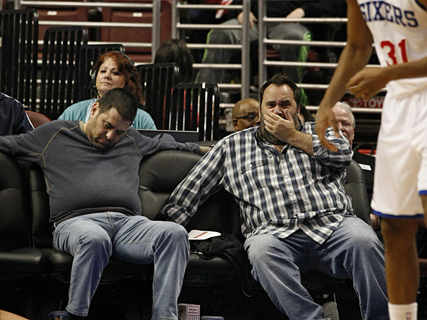 A 76ers fan sleeps during the second half against the Bucks. (Ron Cortes/Staff Photographer)