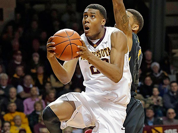 Minnesota forward Charles Buggs goes to the basket past Iowa guard Roy Devyn Marble. (Ann Heisenfelt/AP)