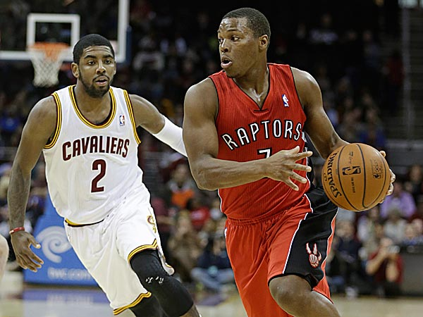 The Raptors´ Kyle Lowry drives past the Cavaliers´ Kyrie Irving. (Tony Dejak/AP)