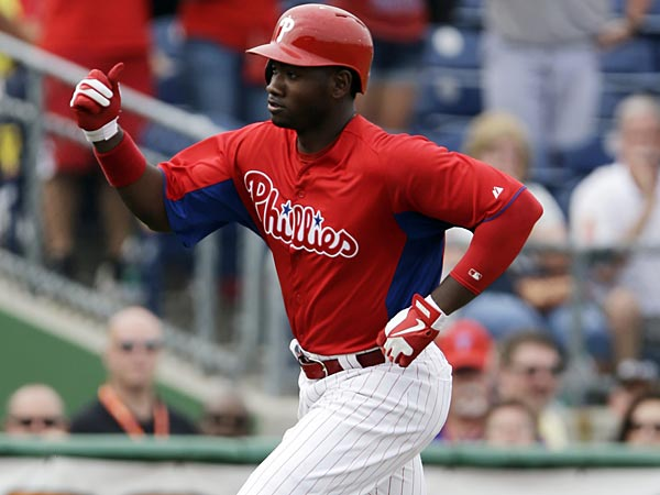 Philadelphia Phillies&acute; Domonic Brown reacts as he rounds the bases<br />after hitting a home run off New York Yankees Zach Nuding during the<br />seventh inning of a spring training exhibition baseball game, Tuesday,<br />Feb. 26, 2013, in Clearwater, Fla. Philadelphia won 4-3. (AP<br />Photo/Matt Slocum)