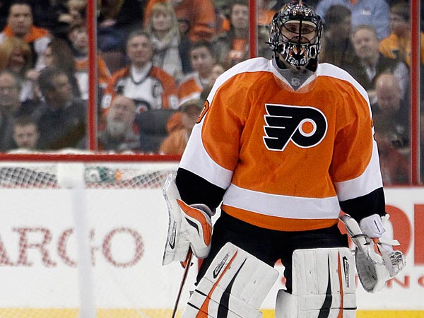 Philadelphia Flyers´ Ilya Bryzgalov leaves the NHL hockey game, skating to the bench in the second period after the Florida Panthers scored for the fourth time, Thursday, Feb. 21, 2013, in Philadelphia. (AP Photo/Tom Mihalek)