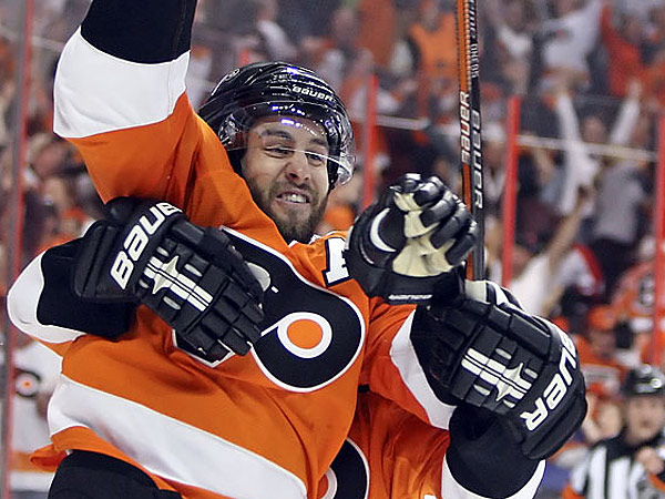 Simon Gagne celebrates his overtime goal in Game 4 against the Bruins during the 2010 Eastern Conference Semifinals. (Steven M. Falk/Staff file photo)