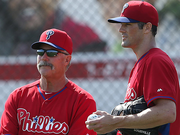 Phillies pitching coach Bob McClure (left) and starting pitcher Cole Hamels (right). (David Maialetti/Staff Photographer)