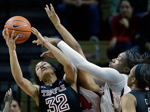 Temple forward Natasha Thames (32) tries to control the ball as she is covered by Rutgers defenders during the second half of an NCAA college basketball game Wednesday, Feb. 26, 2014, in Piscataway, N.J. Rutgers won 67-58. (Mel Evans/AP)