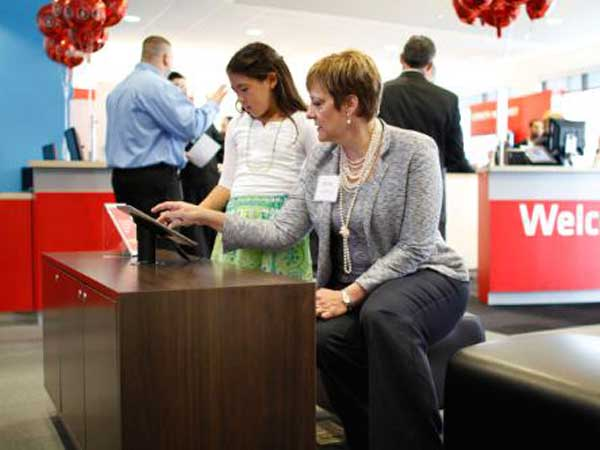 Comcast Regional Senior Vice President LeAnn Talbot demonstrates how to use an Xfinity iPad app to Allison Goodman (10) at the opening ceremony of the new Xfinity store in the Oxford Valley Plaza in Langhorne Pa., on Thursday April 26, 2012. (Comcast Phot o/ Joseph Kaczmarek)