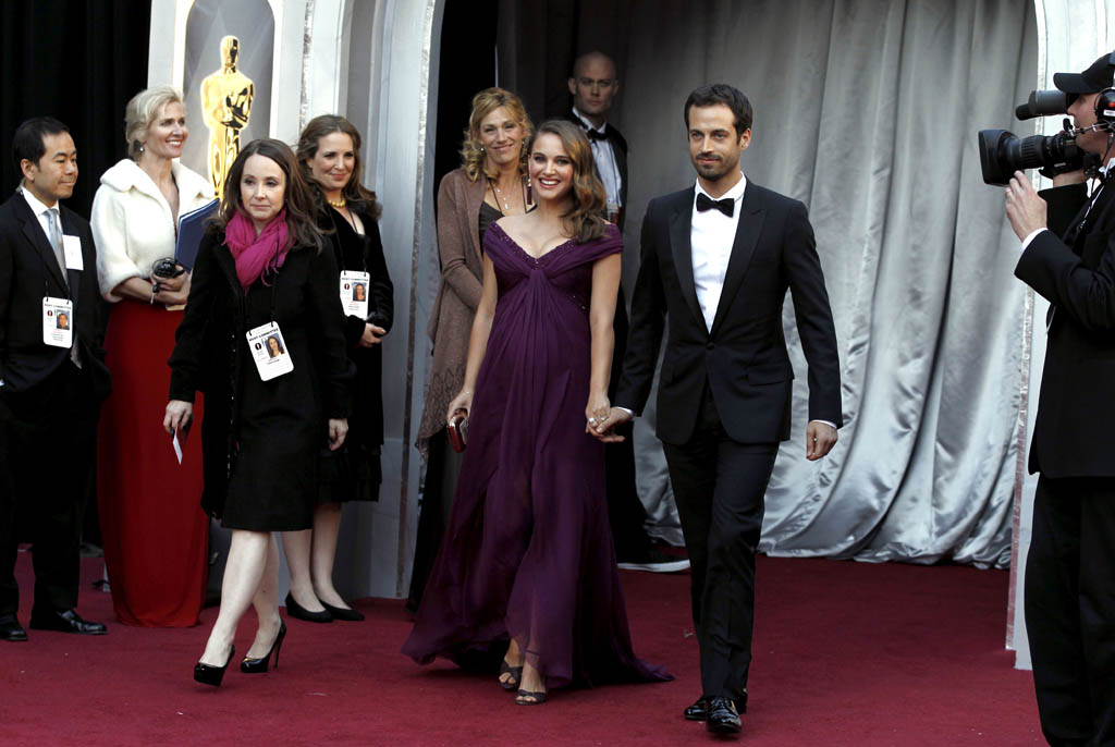 Actress Natalie Portman, left, and Benjamin Millepied arrive before the 83rd Academy Awards on Sunday, Feb. 27, 2011, in the Hollywood section of Los Angeles. (AP Photo/Matt Sayles)